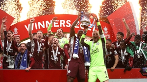 Kasper Schmeichel and Wes Morgan hoist the Cup for the first time in Leicester City's history