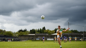 Joe Maher of Offaly kicks a free