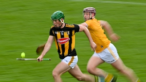 Eoin Cody of Kilkenny races clear of Eoghan Campbell of Antrim