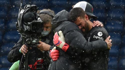 Alisson Becker and Liverpool boss Jurgen Klopp embrace after the final whistle