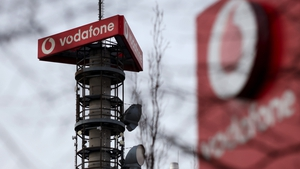 Mobile operator Vodafone has reported a 1.2% drop in full-year adjusted earnings