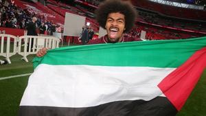 Hamza Choudhury celebrates with a Palestinian flag