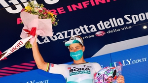 Peter Sagan celebrates on the podium after winning the 10th stage