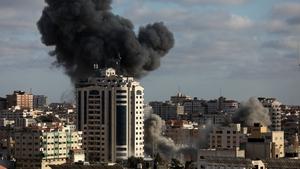 Smoke rises following an Israeli air strike on Gaza City today