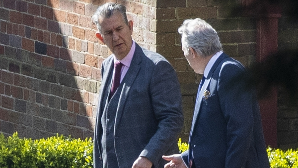 Edwin Poots and Ian Paisley Jnr talk as they leave Stormont House