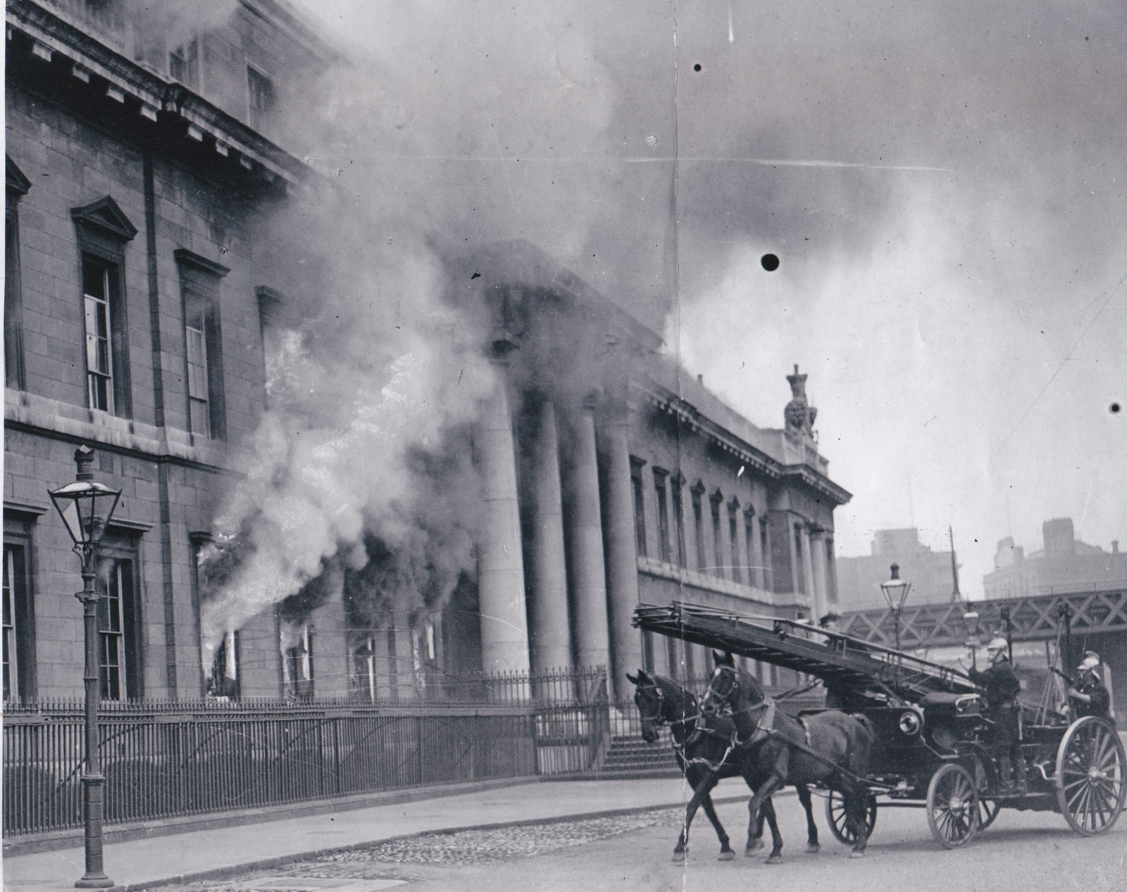 Image - The first units of the Dublin Fire Brigade arriving as the blaze takes hold of the building. Credit: Michael Ward.