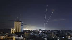 A streak of light appears as Israel's Iron Dome anti-missile system intercepts rockets launched from Gaza