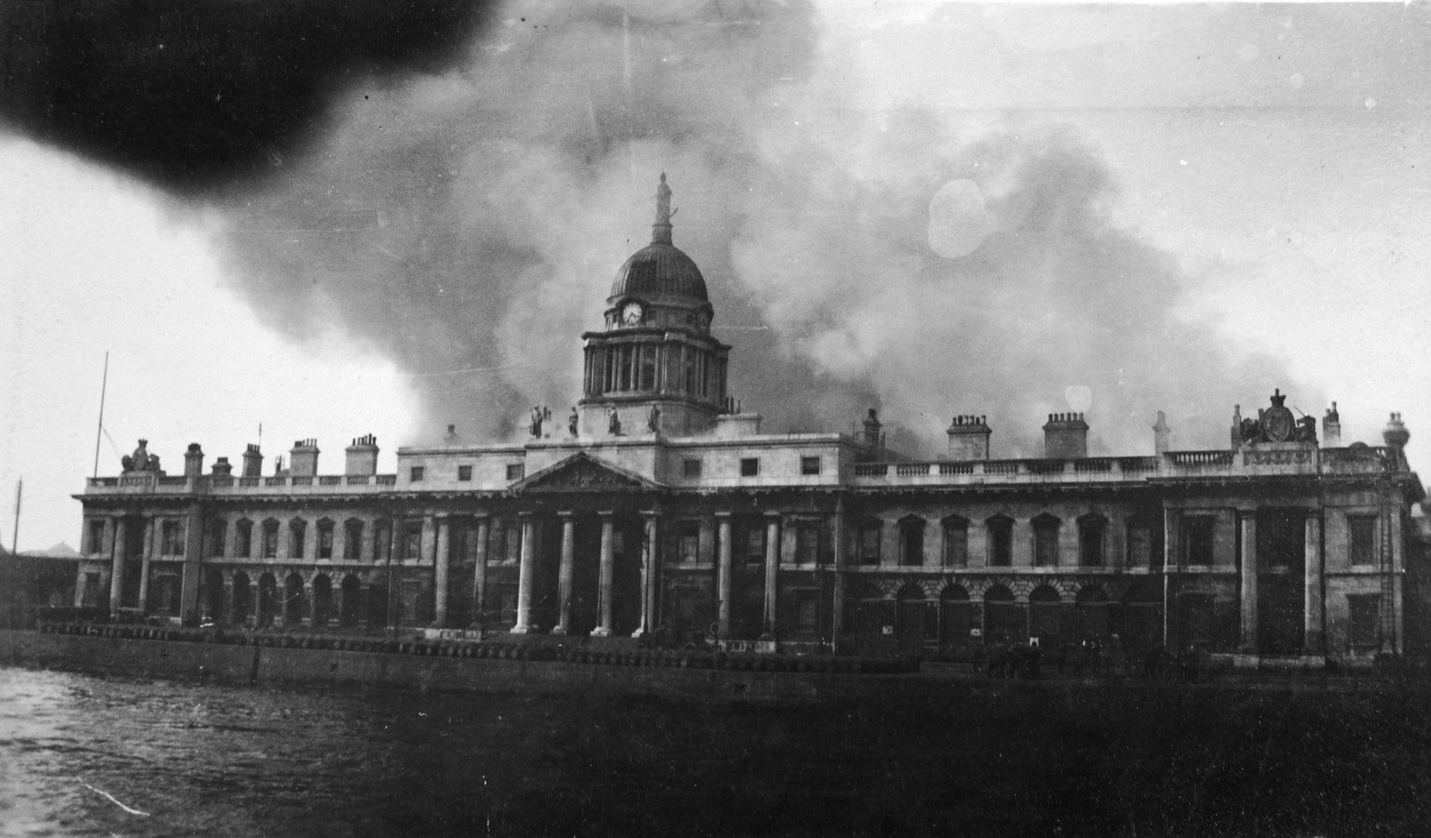 Image - The Custom House as the flames took hold. Credit: Getty Images.