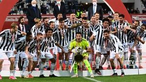 Juventus' goalkeeper Gianluigi Buffon lifts the cup