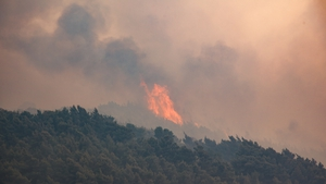 A view of smoke rising from the forest as a wildfire burns in Megara
