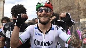 Giacomo Nizzolo celebrates after winning the 13th stage