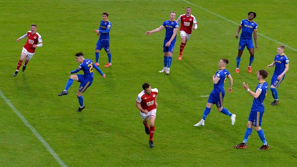 Robbie Benson celebrates after scoring the late, late winner from the spot