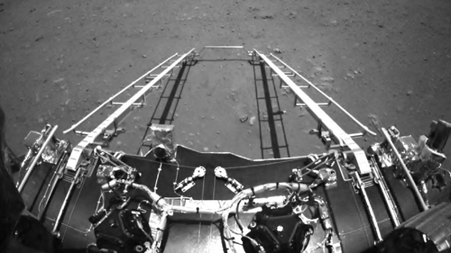 An image taken by Zhurong's front obstacle avoidance camera, showing the deployment of the ramp mechanism after on Mars
