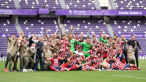 Atletico Madrid players celebrate winning the league title on the final day