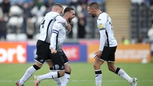 Swansea City's Matt Grimes (C) celebrates with Jake Bidwell (L) and Conor Hourihane after scoring