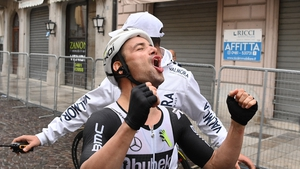 Victor Campenaerts celebrates winning the 15th stage