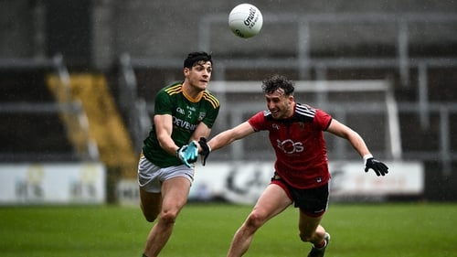 Meath's Seamus Lavin gets a pass away despite the close attention of Down's Barry O'Hagan