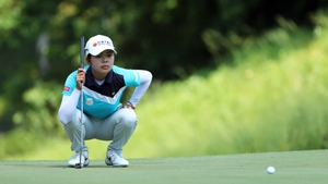 Wei-Ling Hsu of Chinese Taipei lines up her putt on the eighth hole during the final round