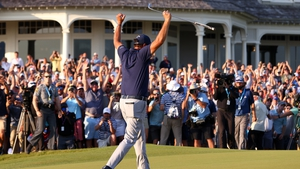 Phil Mickelson celebrates on the 18th green