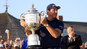 Phil Mickelson celebrates with the Wanamaker Trophy