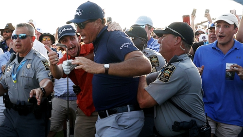 Phil Mickelson at the 18th fairway after playing an approach shot