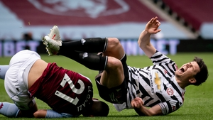 Harry Maguire (R) injured his ankle after Aston Villa's Anwar El Ghazi awkwardly landed on him.