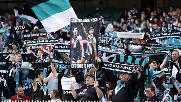 Port Adelaide fans pictured during the AFL clash at the Melbourne Cricket Ground