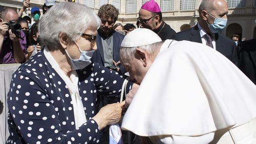 Pope Francis kisses the tattoo on Lidia Maksymowicz's arm