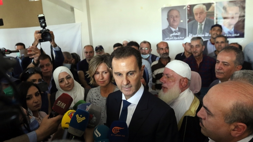 President Assad talks to the media after he and his wife Asma cast their votes in Douma