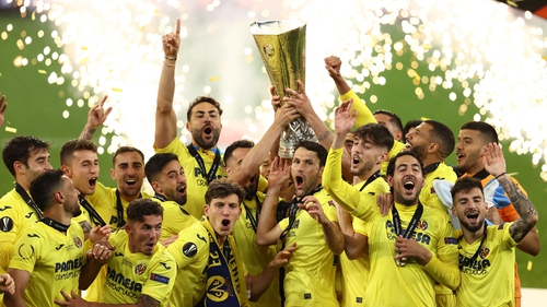 Villarreal players celebrate with the Europa League trophy