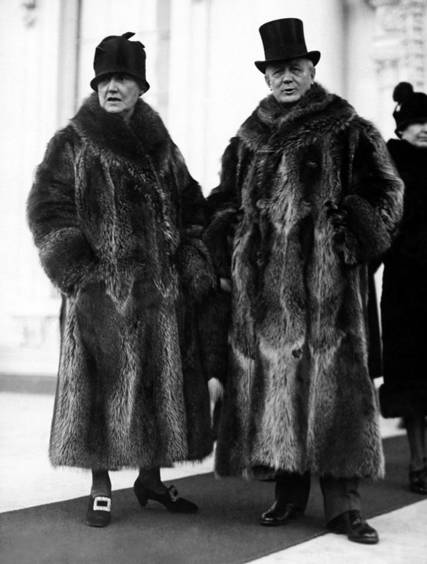 Postmaster General and Mrs Harry New leaving the White House after the New Year reception, Washington DC, January 2, 1928. Their coon skin coats of collegiate fame attracted considerable attention among the more somber formal wear of the other Cabinet members. (Photo by Underwood Archives/Getty Images)
