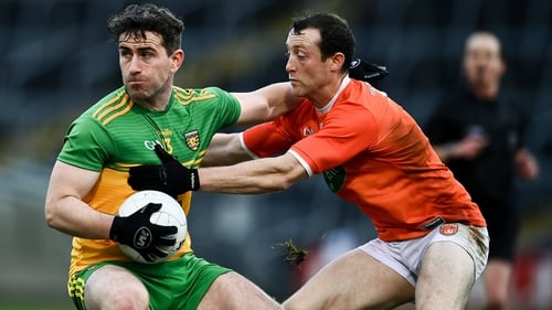 Paddy McBrearty of Donegal in action against Ryan Kennedy of Armagh