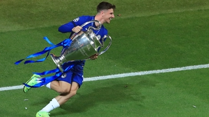 The England midfielder with his hands on the Champions League trophy