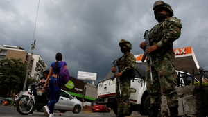 Soldiers guard the streets after the Colombian president ordered more military presence, one day after violent anti-government protests, in Cali