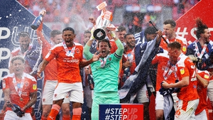 Chris Maxwell of Blackpool lifts the League One Play-off Trophy