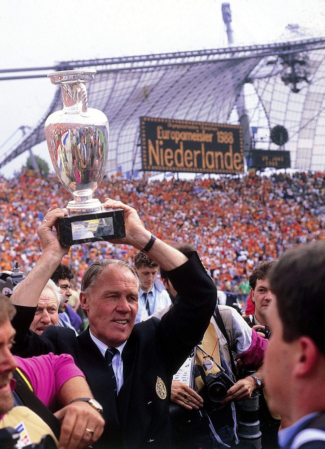 Image - Rinus Michels with the Euro 88 trophy in Munich where he had lost a World Cup final in 1974 also as manager