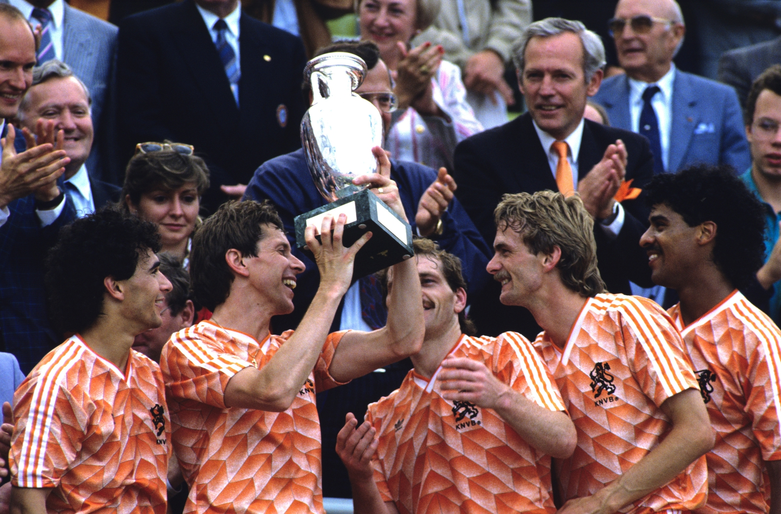 Image - Arnold Muhren holding the trophy aloft as team-mates look on