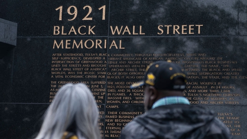 People look at the 1921 Black Wall Street Memorial on the 100th anniversary of the Greenwood massacre in Tulsa, Oklahoma