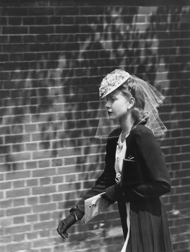 Miss Gordon Duff wearing a small floral victorian hat with outsize veil over a pageboy hairstyle, Ascot Racecourse, Berkshire, 16th June 1938. (Photo by J. A. Hampton/Topical Press Agency/Hulton Archive/Getty Images)