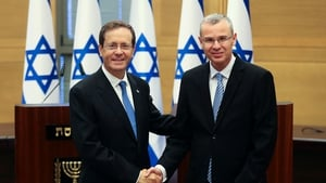 Isaac Herzog (L) shakes hands with Speaker of the Knesset Yariv Levin, after he was elected president
