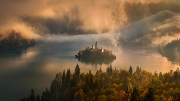 Dawn breaks over Lake Bled in Slovenia (Tomasz Rojek/Nature TTL/PA)