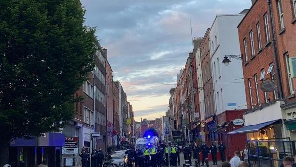 Gardaí lined up at South William Street in Dublin tonight