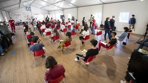 Italians attend a vaccination centre in Rome to receive the Covid-19 jab