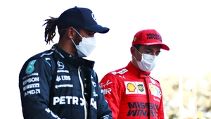 Lewis Hamilton (L) talks with Charles Leclerc after qualifying