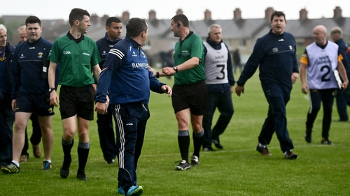 Wexford manager Davy Fitzgerald and Antrim manager Darren Gleeson exchange words at half time