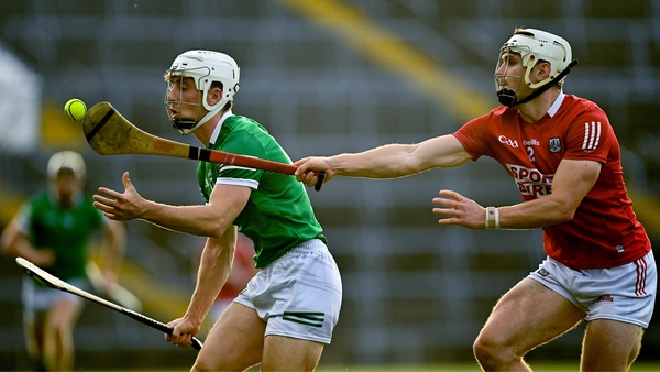 Limerick's Pat Ryan in possession against Cork defender Sean O'Leary-Hayes