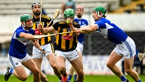 Kilkenny's Tommy Walsh is tackled by Eoin Gaughan, left, and Ross King of Laois