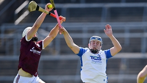 Daithi Burke of Galway in action against Stephen Bennett of Waterford