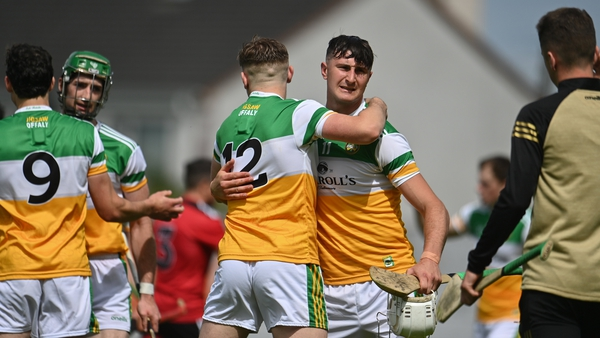 Offaly players Oisín Kelly, centre right, celebrates with team-mate Brian Duignan in Tullamore