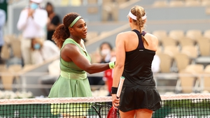 Elena Rybakina of Kazakhstan (R) shakes hands with Serena Williams after the game